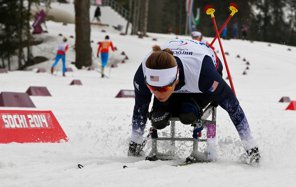 Description of . Oksana Masters of the United States races to win the silver medal in the ladies 12-kilometer cross country ski sitting event at the 2014 Winter Paralympics, Sunday, March 9, 2014, in Krasnaya Polyana, Russia. (AP Photo/Dmitry Lovetsky)