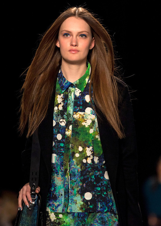 Description of . A model walks the runway during the Rebecca Minkoff Fall 2013 fashion show during Fashion Week, Friday, Feb. 8, 2013, in New York. (AP Photo/Karly Domb Sadof)