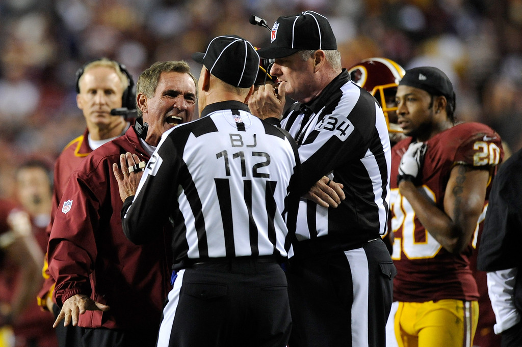 Description of . LANDOVER, MD - DECEMBER 03:  Head coach Mike Shanahan of the Washington Redskins yells at back judge Tony Steratore #112 in the third quarter while taking on the New York Giants at FedExField on December 3, 2012 in Landover, Maryland.  (Photo by Patrick McDermott/Getty Images)