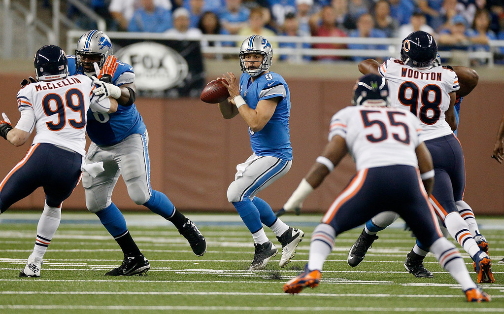 Description of . DETROIT, MI - SEPTEMBER 29:  Matthew Stafford #9 of the Detroit Lions looks to throw while playing the Chicago Bears at Ford Field on September 29, 2013 in Detroit, Michigan. (Photo by Gregory Shamus/Getty Images)