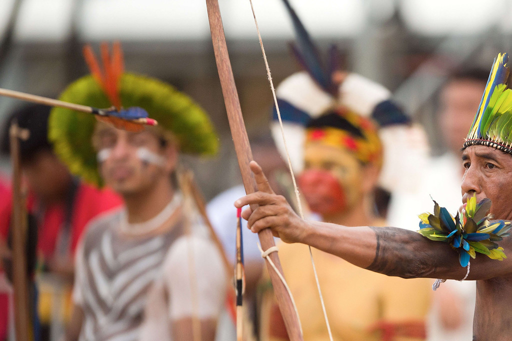 Description of . A Brazilian indigenous man of the Tapicape tribe takes part in the bow and arrow competition during the XII International Games of Indigenous Peoples in Cuiaba, Mato Grosso state, Brazil on November 12, 2013. AFP PHOTO / Christophe SIMON/AFP/Getty Images