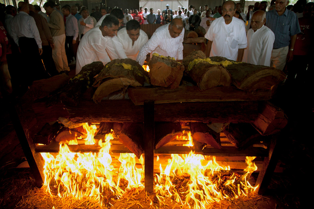 Description of . Family members light the funeral pyre of Mitul Amritlal Shah, of Bidco Group of Kenya,who was shot dead in the attack on the Westgate Mall,  at the Hindu Crematorium in Nairobi, Kenya Thursday, Sept. 26, 2013. (AP Photo/Sayyid Azim)
