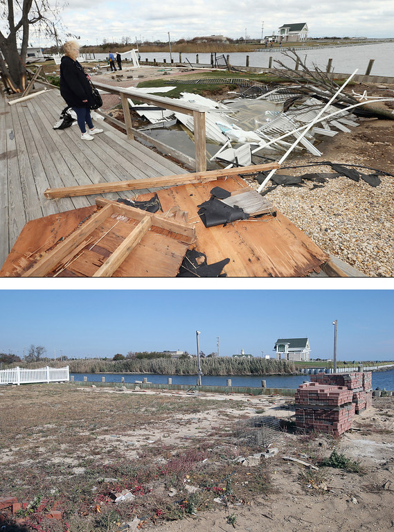 Description of . AMITY HARBOR, NY - OCTOBER 31: (top) Resident Pat Lore checks out the damage caused to her home from Hurricane Sandy on the Western Concourse on October 31, 2012 in Amity Harbor, New York. AMITY HARBOR, NY - OCTOBER 22: (bottom) The backyard of a home sits empty almost one year after sustaining damage from Superstorm Sandy on October 22, 2013 in Amity Harbor, New York. Hurricane Sandy made landfall on October 29, 2012 near Brigantine, New Jersey and affected 24 states from Florida to Maine and cost the country an estimated $65 billion. (Photos by Bruce Bennett/Getty Images)