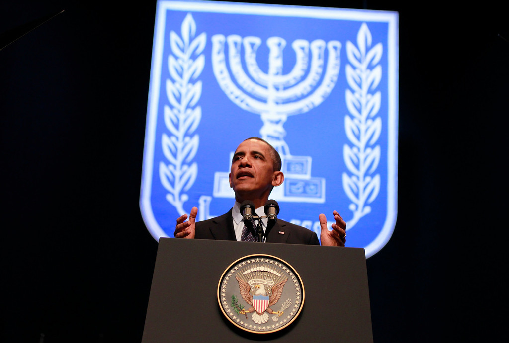 Description of . U.S. President Barack Obama delivers a policy speech at the Jerusalem Convention Center, March 21, 2013.  Obama appealed directly on Thursday to the Israeli people to put themselves in the shoes of stateless Palestinians and recognize that Jewish settlement activity in occupied territory hurts prospects for peace. REUTERS/Jason Reed