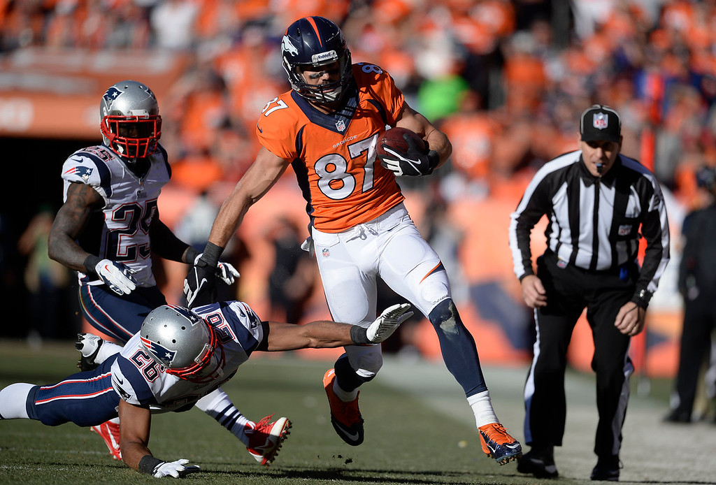 Description of . Denver Broncos wide receiver Eric Decker (87) makes a first down in the third quarter. The Denver Broncos take on the New England Patriots in the AFC Championship game at Sports Authority Field at Mile High in Denver on January 19, 2014. (Photo by AAron Ontiveroz/The Denver Post)
