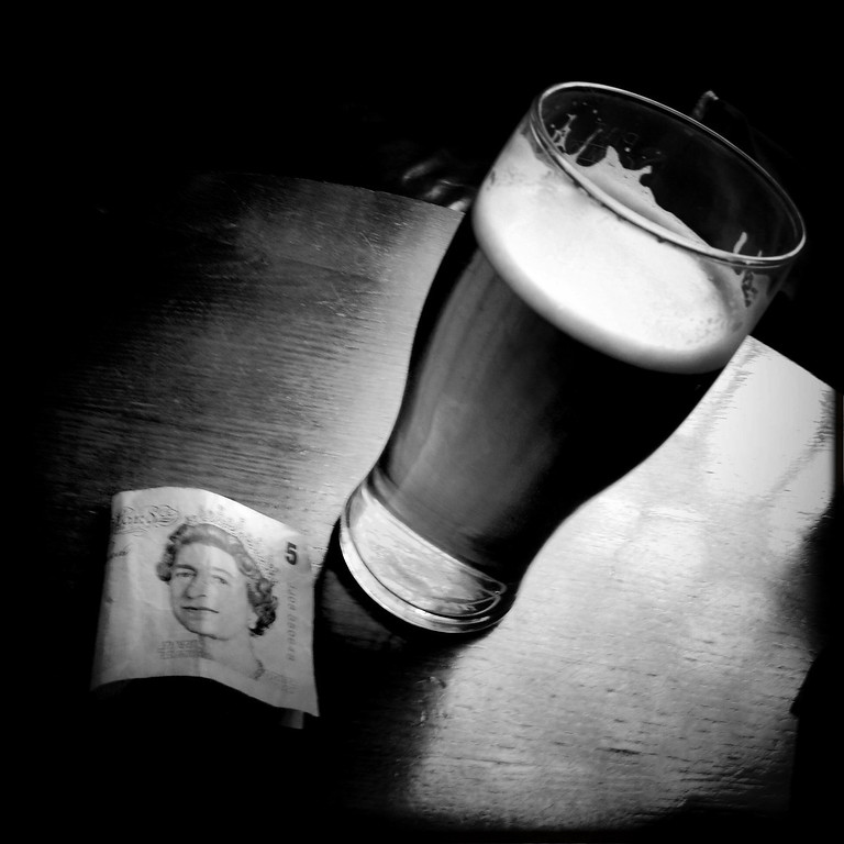 Description of . A pint of beer and a five pounds banknote on May 2, 2012 in London, England. Shot in April 2012 ahead of the London 2012 Olympics. (Photo by Vittorio Zunino Celotto/Getty Images)