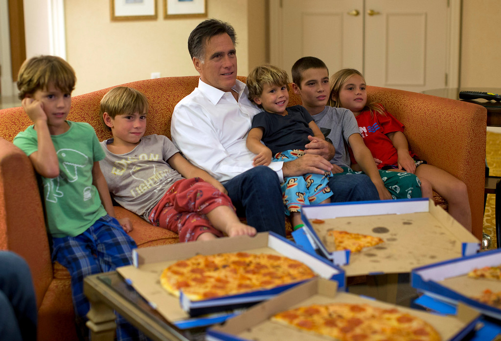 Description of . In this Aug. 29, 2012 file photo, Republican presidential candidate, former Massachusetts Gov. Mitt Romney watches the Republican National Convention with his grandchildren from his hotel room in Tampa, Fla.  (AP Photo/Evan Vucci, File)