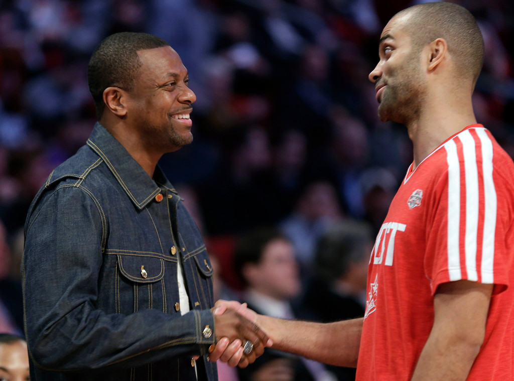 Description of . Actor Chris Tucker, left, and Tony Parker of the San Antonio Spurs talk during NBA basketball All-Star Saturday Night, Feb. 16, 2013, in Houston. (AP Photo/Eric Gay)