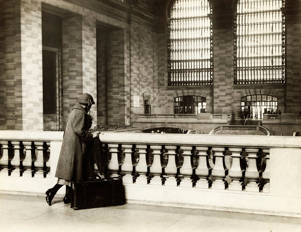 Description of . A woman with a suitcase stands at the top level of Grand Central Station in New York City in this undated handout photo. It made its debut in the heyday of cross-country train travel, faced demolition in the era of the auto, and got a new lease on life with a facelift in its eighth decade. Now Grand Central Terminal, the doyenne of American train stations, is celebrating its 100th birthday. Opened on Feb. 2, 1913, when trains were a luxurious means of traveling across America, the iconic New York landmark with its Beaux-Arts facade is an architectural gem, and still one of America's greatest transportation hubs. REUTERS/Bettmann Archive/Corbis