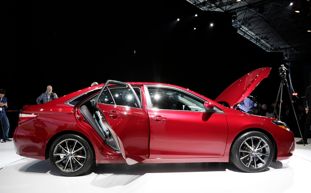 . Members of the media view the 2015 Toyota Camry at the New York International Auto Show, Wednesday, April 16, 2014, in New York. (AP Photo/Mark Lennihan)