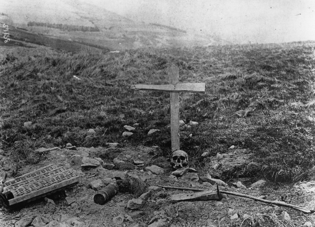 Description of . June 1915:  The grave of a German soldier, marked by a simple wooden cross and a skull.  (Photo by Hulton Archive/Getty Images)