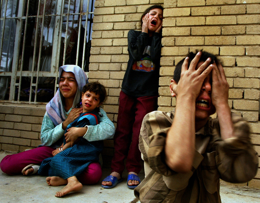 Description of . Family members mourn the death of three male relatives, in Baghdad, Iraq Thursday, April 10, 2003. The three - a father, his teenage son, and another male relative - were shot and killed by U.S. Marines Wednesday night, April 9, after the car they were driving allegedly did not stop while passing a building occupied by U.S. Marines. The victims\' relatives were waiting for their return, and did not know about the incident until relatives towed the car, containing the three bodies, to the family\'s home on Thursday. (AP Photo/Carolyn Cole, Los Angeles Times)