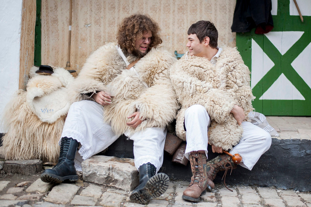 Description of . Young revelers wearing sheep-fur costumes chat as they get ready for the traditional carnival parade in the yard of a house in Mohacs, 189 kms south of Budapest, Hungary, 27 February 2014.   EPA/TAMAS SOKI