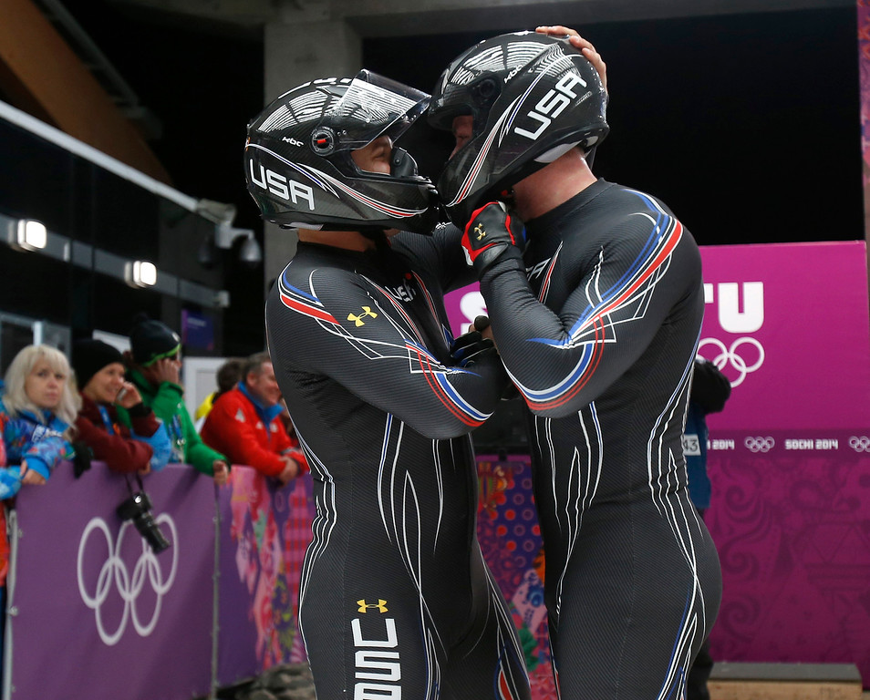 Description of . USA-3 driven by Nick Cunningham, left, with Dallas Robinson celebrate their Heat 4 run for the Two-man Bobsleigh at the Sliding Center Sanki for the 2014 Winter Olympics in Krasnaya Polyana, Russia on Monday, Feb. 17, 2014.  (Nhat V. Meyer/Bay Area News Group)
