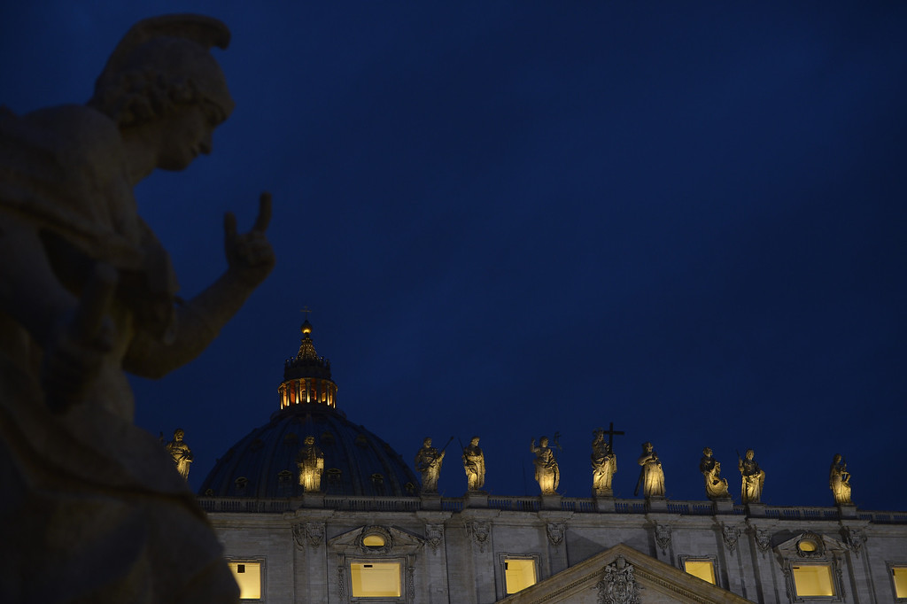 Description of . A picture shows statues on the St Peter\'s basilica during the conclave on March 12, 2013 at the Vatican.    AFP PHOTO / FILIPPO MONTEFORTE/AFP/Getty Images