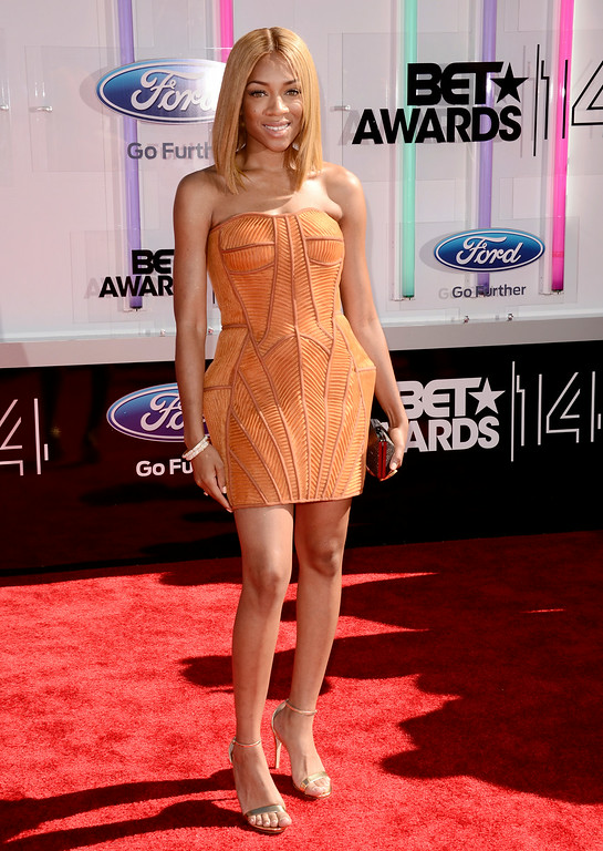 Description of . Lil Mama arrives at the BET Awards at the Nokia Theatre on Sunday, June 29, 2014, in Los Angeles. (Photo by Dan Steinberg/Invision/AP)