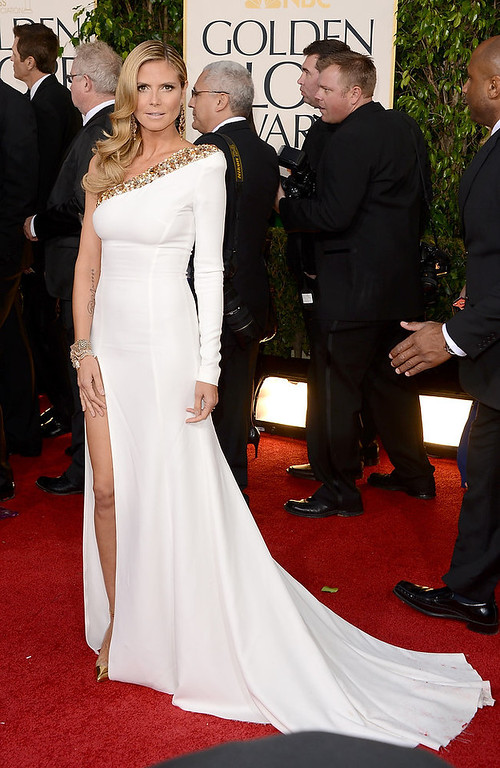 Description of . TV personality Heidi Klum arrives at the 70th Annual Golden Globe Awards held at The Beverly Hilton Hotel on January 13, 2013 in Beverly Hills, California.  (Photo by Jason Merritt/Getty Images)