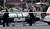 The Orange County coroner's office wheels a body to a waiting van in Orange, Calif., Tuesday, Feb. 19, 2013. (AP Photo/The Orange County Register, Mark Rightmire)