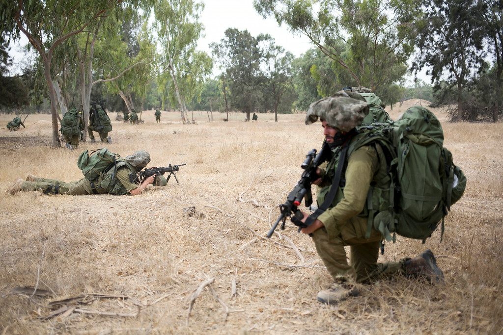 Description of . Israeli soldiers take positions during a drill near the Israel and Gaza border, Tuesday, July 22, 2014. Israeli airstrikes pummeled a wide range of targets in the Gaza Strip on Tuesday as the U.N. chief and the U.S. secretary of state began an intensive effort to end more than two weeks of fighting that has killed hundreds of Palestinians and dozens of Israelis. (AP Photo/Dusan Vranic)