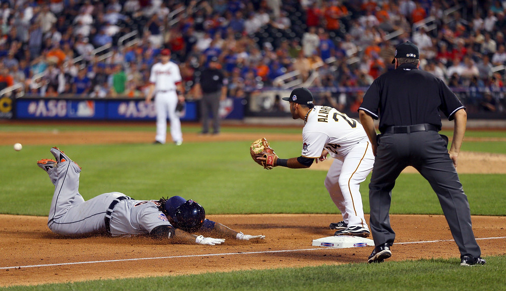 Description of . American League All-Star David Ortiz #34 of the Boston Red Sox slides into third base for a triple in front of the tag of National League All-Star Pedro Alvarez #24 of the Pittsburgh Pirates in the ninth inning during the 84th MLB All-Star Game on July 16, 2013 at Citi Field in the Flushing neighborhood of the Queens borough of New York City.  (Photo by Mike Ehrmann/Getty Images)