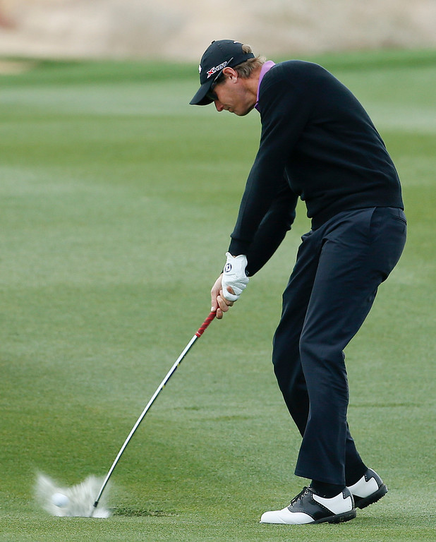 Description of . Nicolas Colsaerts, of Belgium, hits out of standing water on the 13th fairway in the first round against Bill Haas during the Match Play Championship golf tournament, Thursday, Feb. 21, 2013, in Marana, Ariz. Colsaerts won 5 and 4. (AP Photo/Ross D. Franklin)