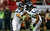Russell Wilson #3 hands the ball off to  Marshawn Lynch #24 of the Seattle Seahawks in the second quarter against the Atlanta Falcons during the NFC Divisional Playoff Game at Georgia Dome on January 13, 2013 in Atlanta, Georgia.  (Photo by Kevin C. Cox/Getty Images)