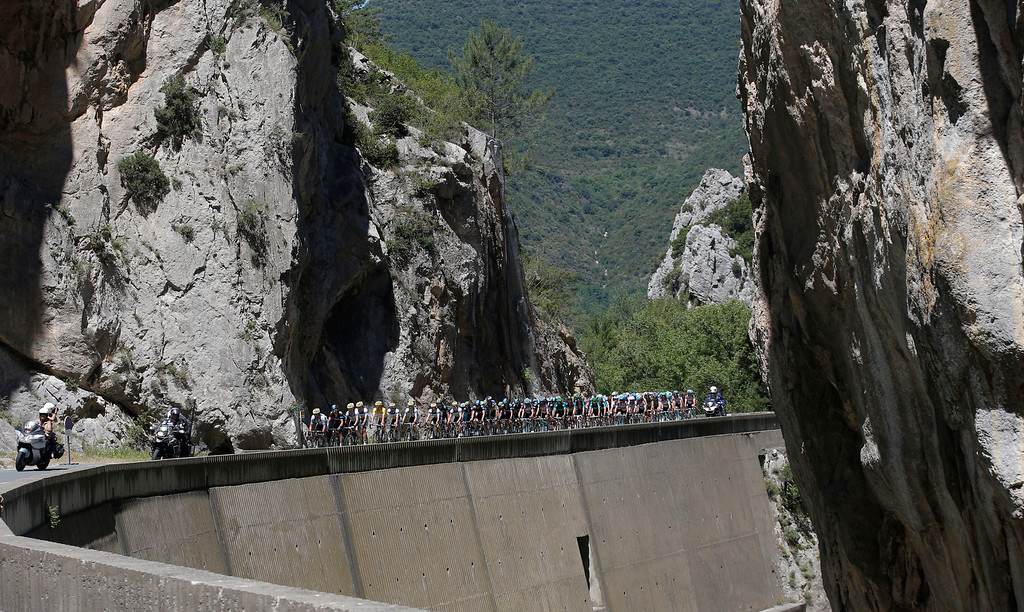 Description of . The pack climbs towards Pailheres pass during the eight stage of the Tour de France cycling race over 195 kilometers (122 miles) with start in Castres and finish in Ax 3 Domaines, Pyrenees region, France, Saturday July 6 2013. (AP Photo/Christophe Ena)