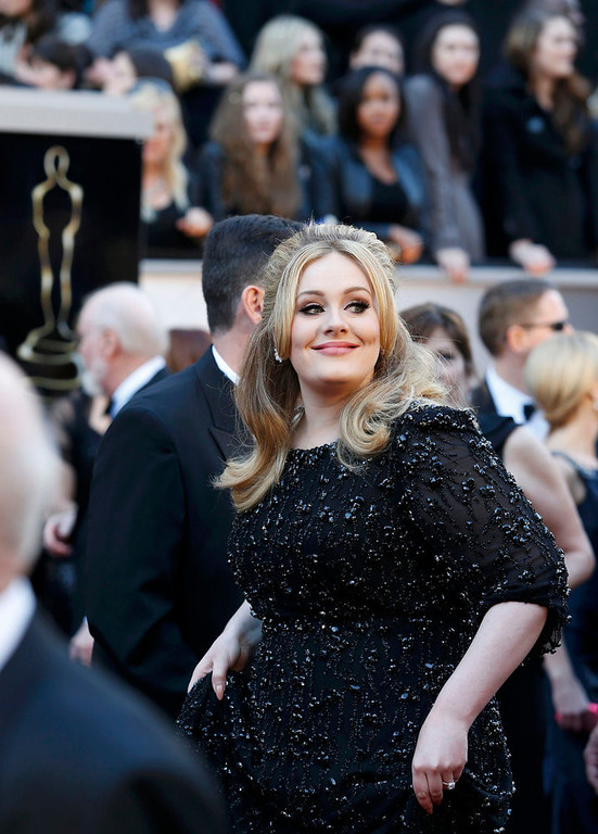 Description of . Singer Adele arrives at the 85th Academy Awards in Hollywood, California February 24, 2013.  REUTERS/Adrees Latif