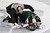Minnesota Wild's Cal Clutterbuck is tended to by a trainer after being hit by Edmonton Oilers Taylor Hall during third period NHL hockey action in Edmonton, Alberta, on Thursday Feb. 21, 2013. (AP Photo/THE CANADIAN PRESS,Jason Franson)