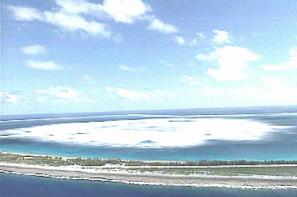 Description of . The sea close to the shore of Fangataufa Atoll, about 750 miles from the French Polynesian capital of Papeete, in the South Pacific turns white following the detonation of an underground French nuclear test in this image taken from French Military footage, Sunday October 1, 1995. The test, the second detonated by France in a month, measured more than five times stronger than the 20 kiloton earlier test, carried out on Sept. 5 on the neighboring Atoll of Mururoa. (AP Photo/TV)