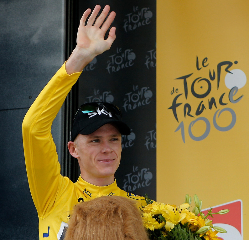 Description of . Stage winner Christopher Froome of Britain, wearing the overall leader's yellow jersey, celebrates on the podium of the seventeenth stage of the Tour de France cycling race an individual time trial over 32 kilometers (20 miles) with start in Embrun and finish in Chorges, France, Wednesday July 17, 2013. (AP Photo/Christophe Ena)