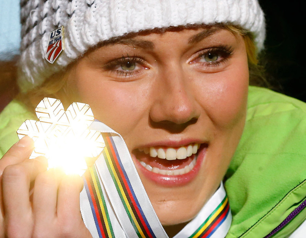 Description of . Mikaela Shiffrin of the U.S. shows her gold medal during the medal ceremony of the women's slalom event at the FIS alpine skiing world championships in Schladming February 16, 2013. REUTERS/Dominic Ebenbichler