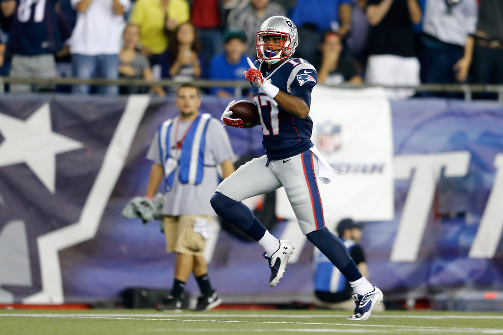 Description of . Wide receiver Aaron Dobson #17 of the New England Patriots celebrates as he runs to score on a 39-yard catch in the first quarter against the New York Jets at Gillette Stadium on September 12, 2013 in Foxboro, Massachusetts.  (Photo by Jim Rogash/Getty Images)