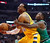 Chicago Bulls guard Nate Robinson, right, fouls Denver Nuggets guard Andre Iguodala during the first half of an NBA basketball game, Monday, March 18, 2013, in Chicago. (AP Photo/Charles Rex Arbogast)