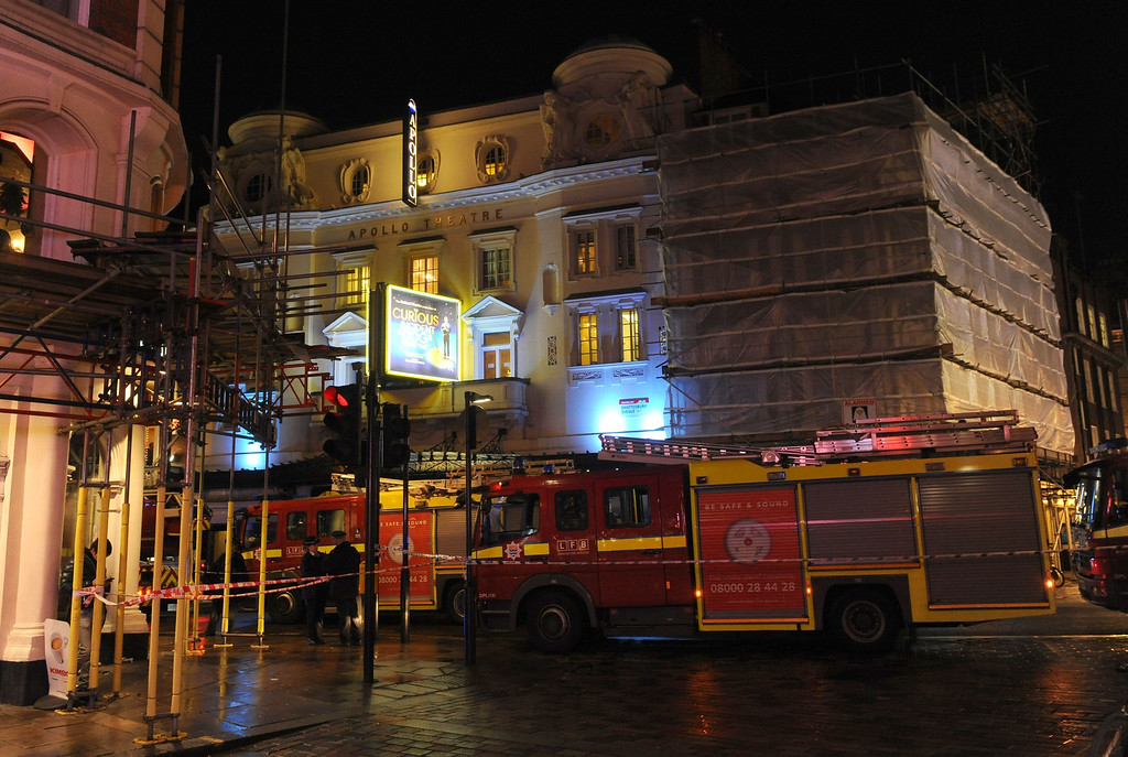 """. Emergency services attend the scene at the Apollo Theatre in Shaftesbury Avenue, central London, Thursday, Dec. 19, 2013. A theater in central London partially collapsed Thursday night during a performance at the height of the Christmas season, with police saying there were \""""a number\"""" of casualties. (AP Photo/PA, Dominic Lipinski)"""