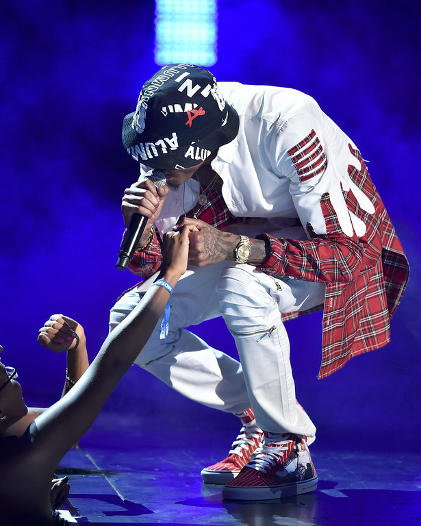 Description of . Singer August Alsina performs onstage during the BET AWARDS '14 at Nokia Theatre L.A. LIVE on June 29, 2014 in Los Angeles, California.  (Photo by Kevin Winter/Getty Images for BET)