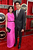 Actors Freida Pinto (L) and Dev Patel arrive at the 19th Annual Screen Actors Guild Awards held at The Shrine Auditorium on January 27, 2013 in Los Angeles, California.  (Photo by Kevork Djansezian/Getty Images)