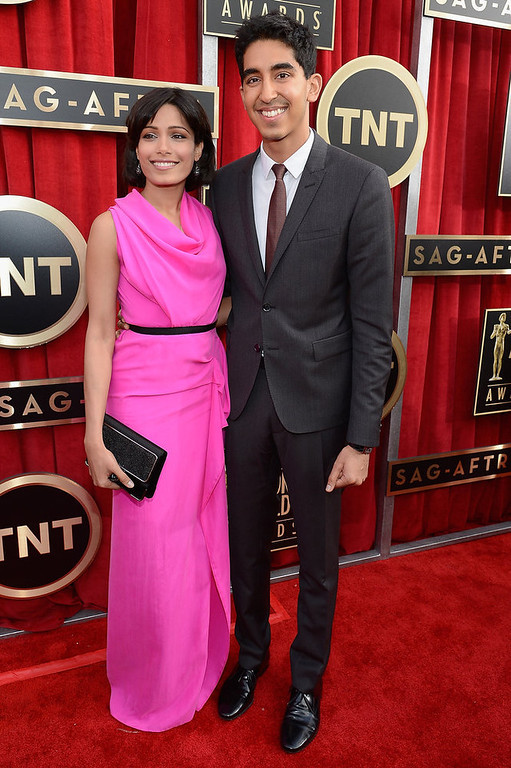. Actors Freida Pinto (L) and Dev Patel arrive at the 19th Annual Screen Actors Guild Awards held at The Shrine Auditorium on January 27, 2013 in Los Angeles, California.  (Photo by Kevork Djansezian/Getty Images)