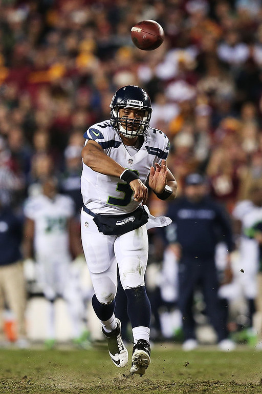 Description of . Russell Wilson #3 of the Seattle Seahawks throws the ball in the second quarter of their NFC Wild Card Playoff Game against the Washington Redskins at FedExField on January 6, 2013 in Landover, Maryland.  (Photo by Win McNamee/Getty Images)