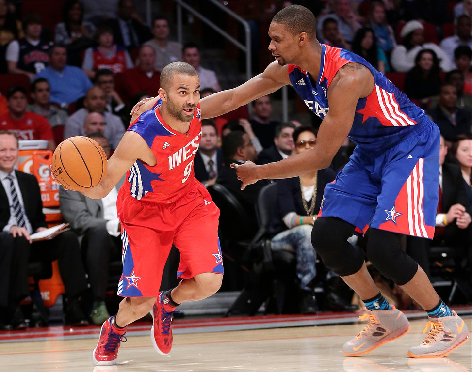 Description of . West Team's Tony Parker from France, of the San Antonio Spurs drives against East Team's Chris Bosh of the Miami Heat during the first half of the NBA All-Star basketball game Sunday, Feb. 17, 2013, in Houston. (AP Photo/Eric Gay)