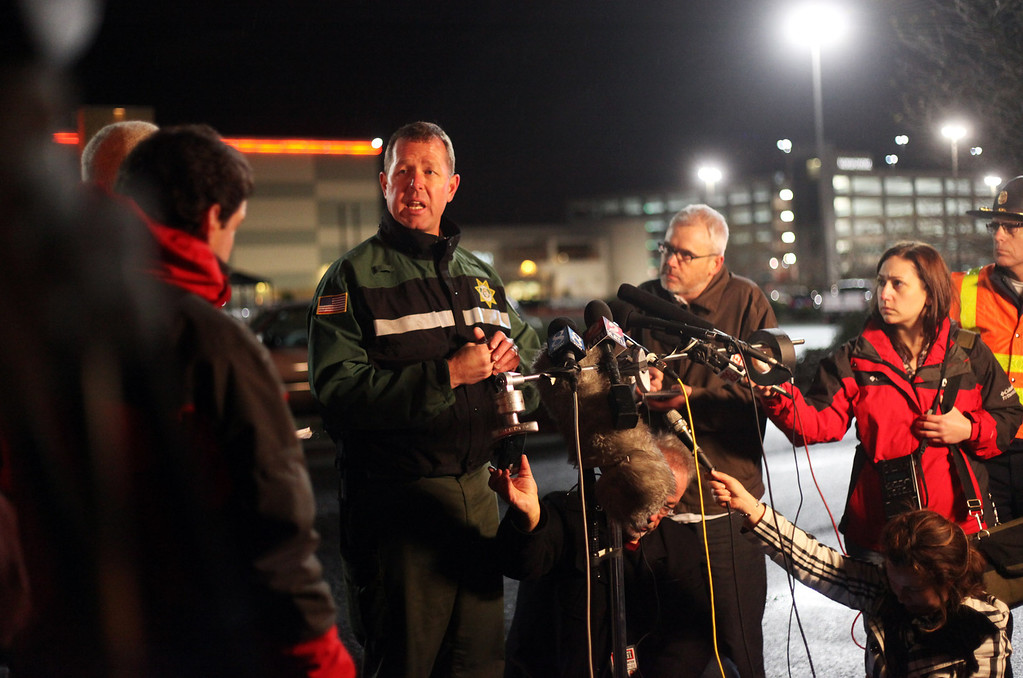Description of . Clackamas County Sheriffs Sgt. Adam Phillips speaks during a news conference outside the Clackamas Town Center in Portland, Ore., Tuesday, Dec. 11, 2012. A gunman opened fire in the suburban Portland shopping mall Tuesday, killing two people and wounding another as people were doing their Christmas shopping, authorities said. (AP Photo/Statesman-Journal, Thomas Patterson)
