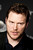 Chris Pratt speaks with reporters at the Newseum during the