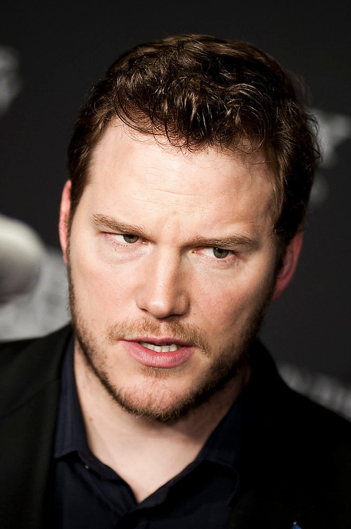 Description of . Chris Pratt speaks with reporters at the Newseum during the
