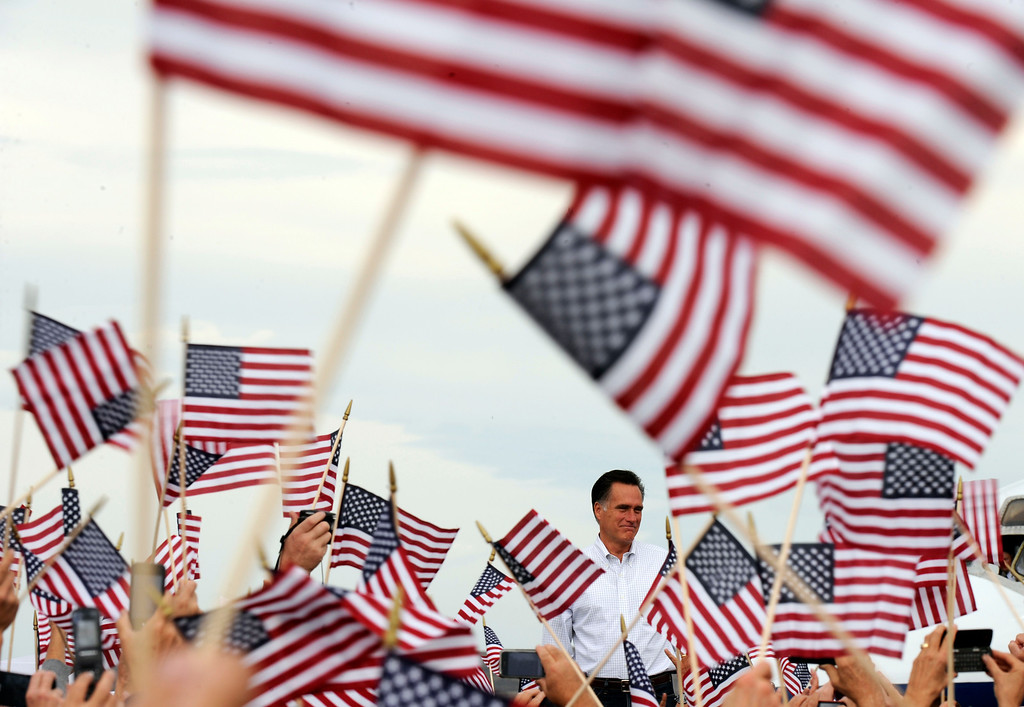 Description of . Republican presidential nominee Mitt Romney greets a crowd, Monday September 24, 2012, during a campaign rally in Pueblo. RJ Sangosti, The Denver Post