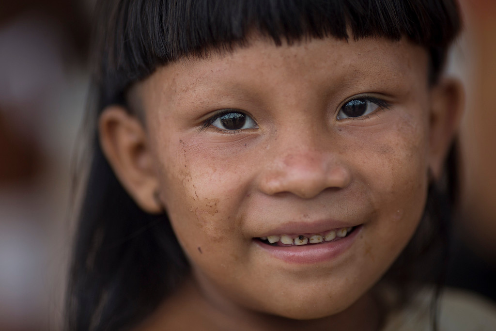 Description of . An Enawene Nawe Indian looks at the camera during the indigenous games in Cuiaba, Brazil, Tuesday, Nov. 12, 2013. (AP Photo/Felipe Dana)