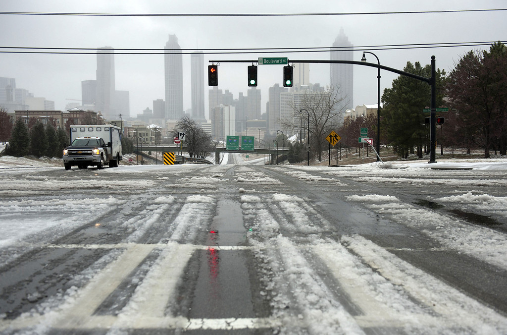 Description of . Roads were nearly empty as conditions worsened ion February 12, 2014 in Atlanta, Georgia. Public schools were closed for another day, and hazardous road conditions kept most people home. A state of emergency was declared in 45 Georgia counties as sleet, freezing rain and snow fell across the state. (Photo by Davis Turner/Getty Images)