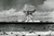 The mushroom cloud of an atom bomb rises among abandoned ships in Bikini lagoon on July 1, 1946 after the bomb was dropped from the Super Fortress 