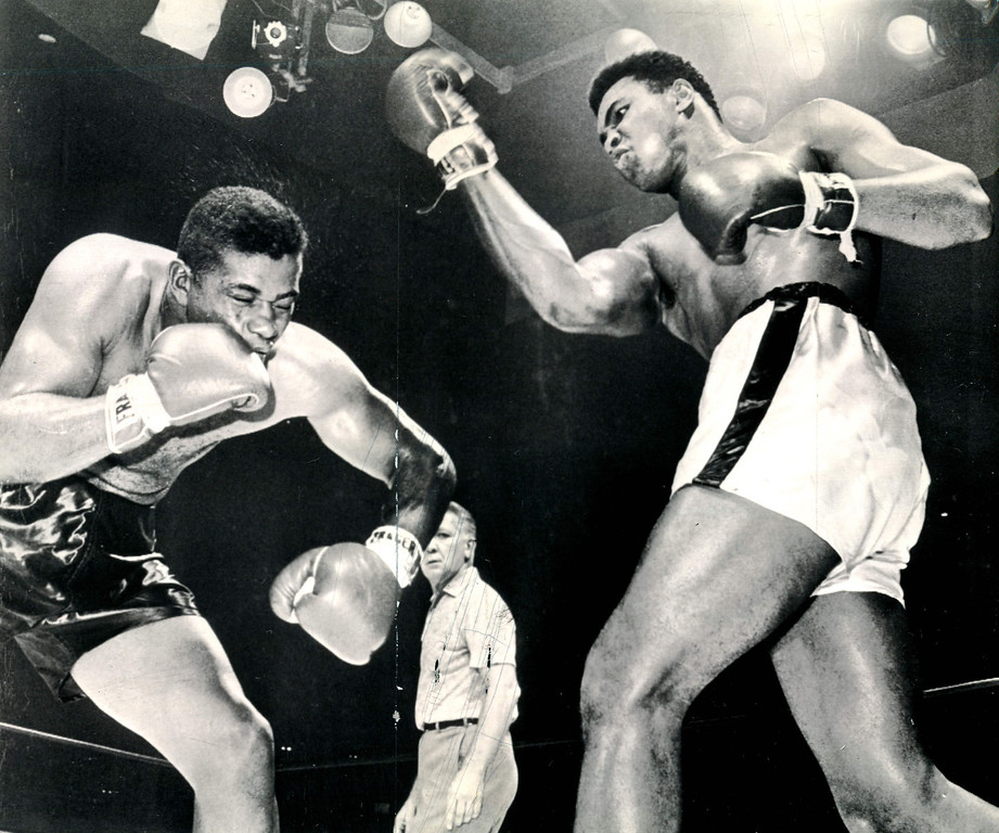 Description of . Floyd Patterson appears groggy with his knees about to go under as champion Cassius Clay whips another sweeping blast to his face a moment before their heavyweight title fight was stopped at Las Vegas, Nev., 1965.  Referee Harry Krause stepped in to call a 12th round technical knockout.    Credit: AP
