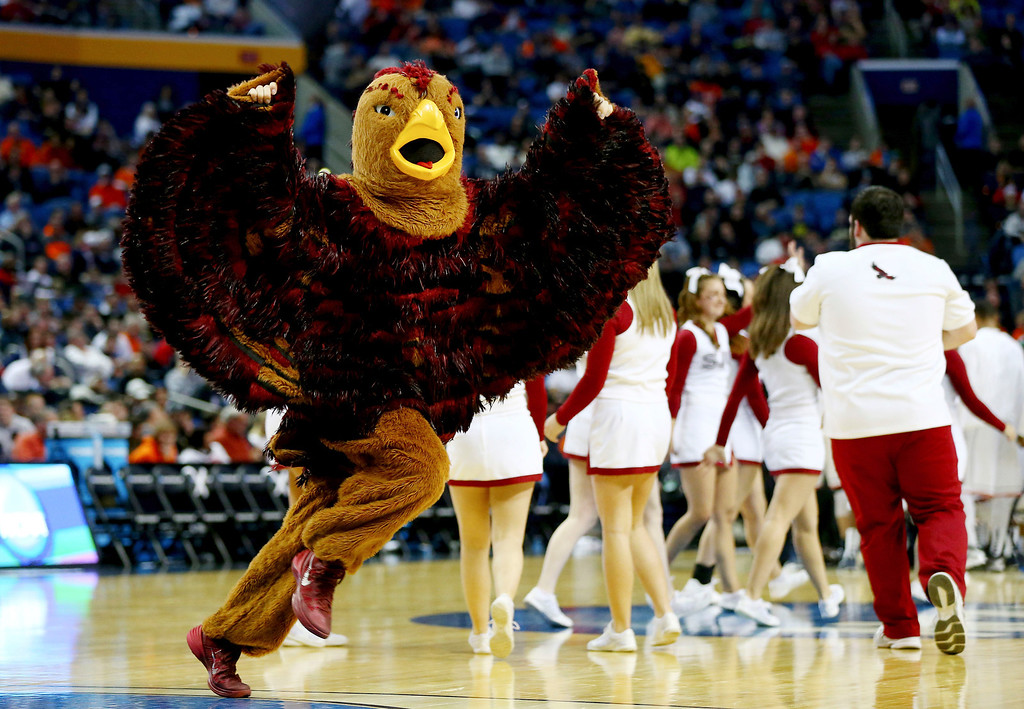 Description of . The Saint Joseph's Hawks mascot perofrms during the second round of the 2014 NCAA Men's Basketball Tournament against the Connecticut Huskies at the First Niagara Center on March 20, 2014 in Buffalo, New York.  (Photo by Elsa/Getty Images)