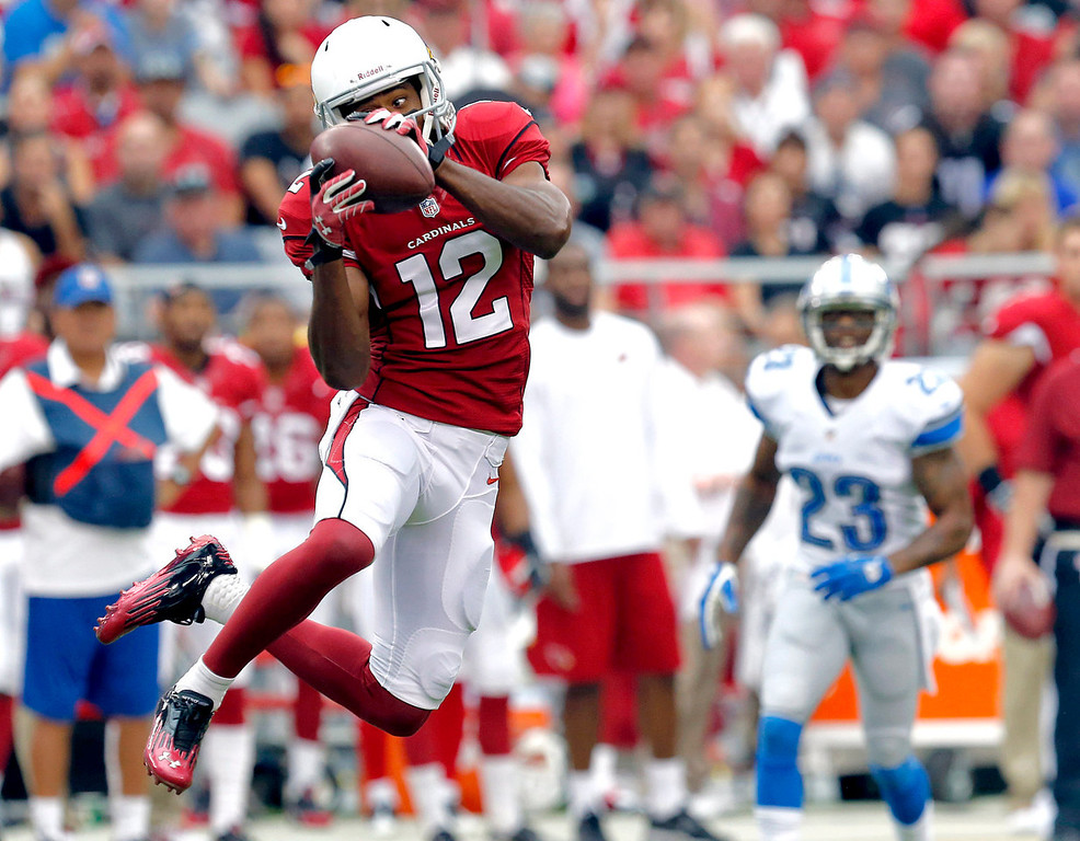 Description of . Arizona Cardinals wide receiver Andre Roberts (12) pulls in a pass against the Detroit Lions during the first half of a NFL football game, Sunday, Sept. 15, 2013, in Glendale, Ariz. (AP Photo/Ross D. Franklin)